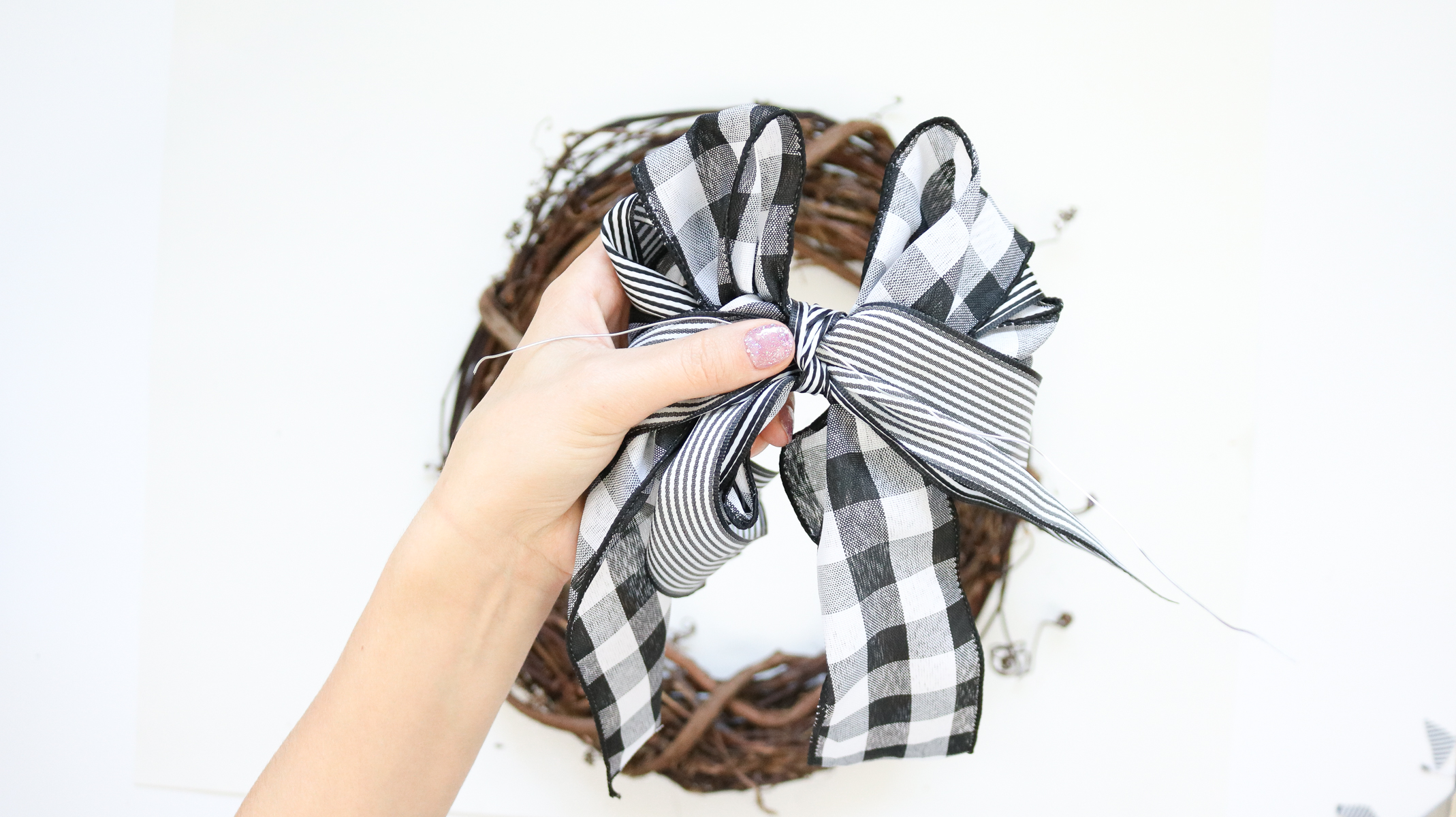 making the bow for plaid wreath DIY