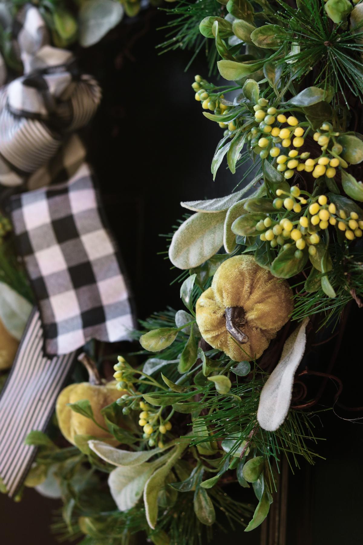 tiny velvet pumpkins on plaid wreath DIY