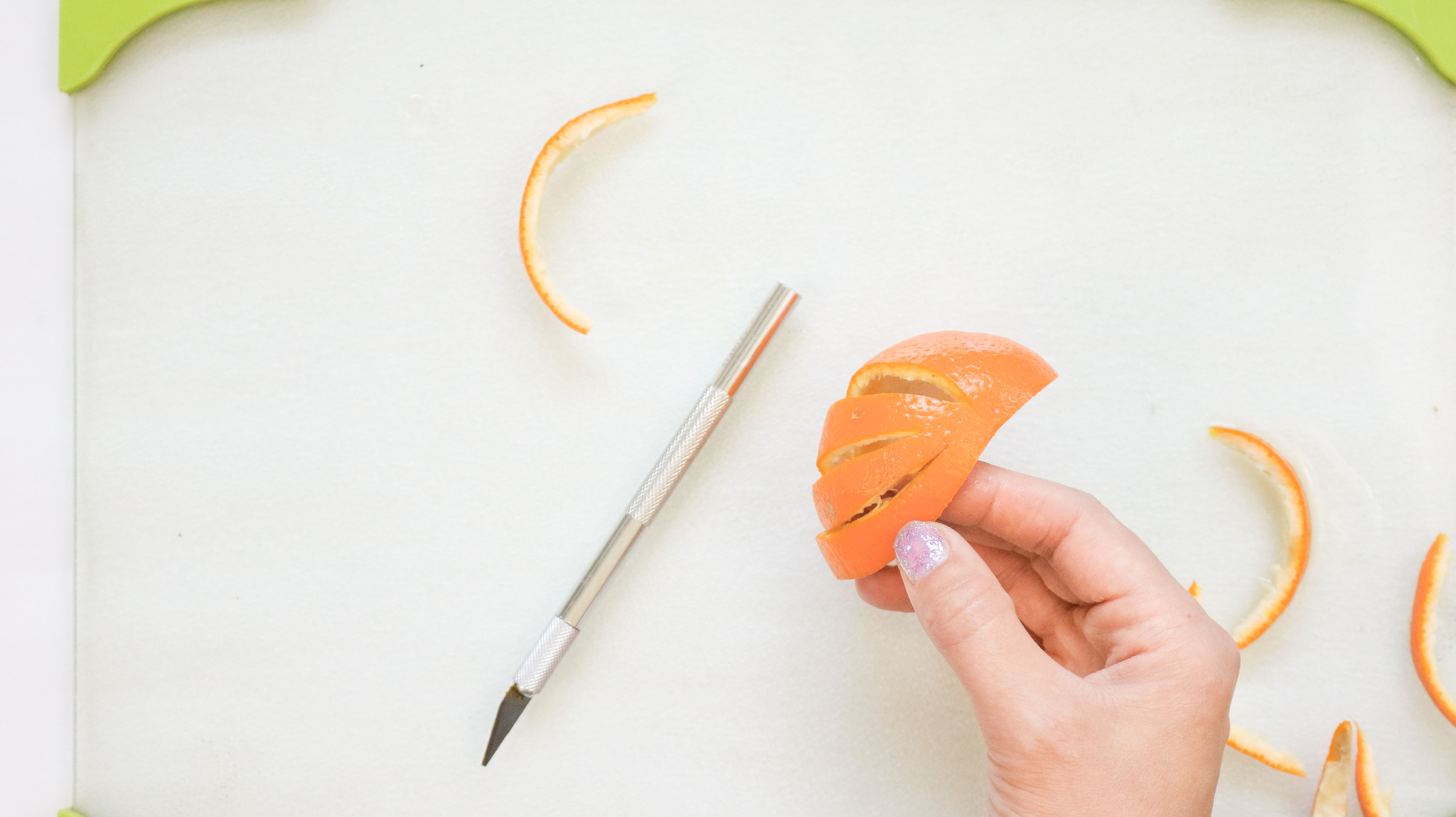 cutting into citrus before drying