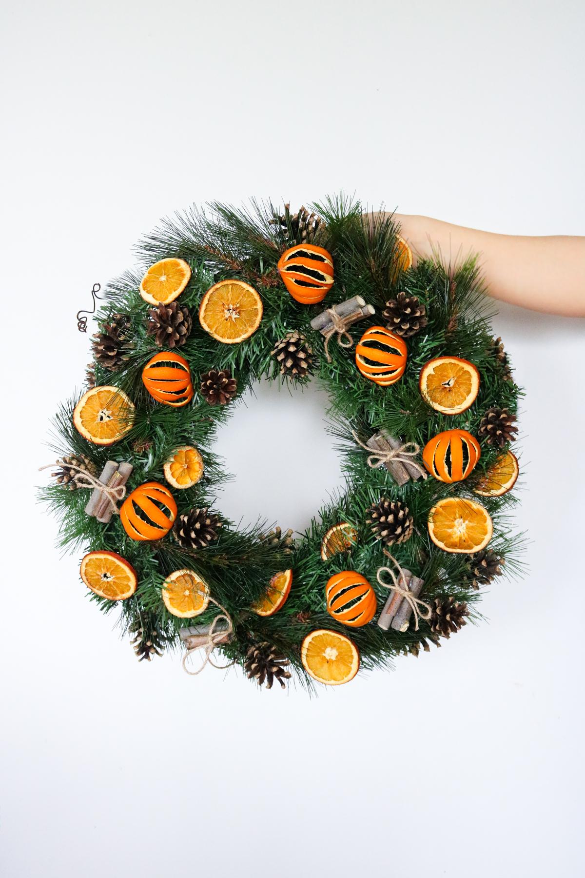 DIY citrus wreath against a white background