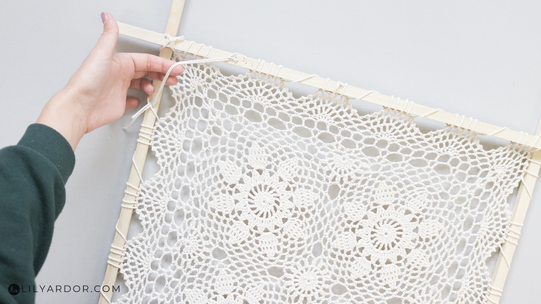 attaching the doily to the frame