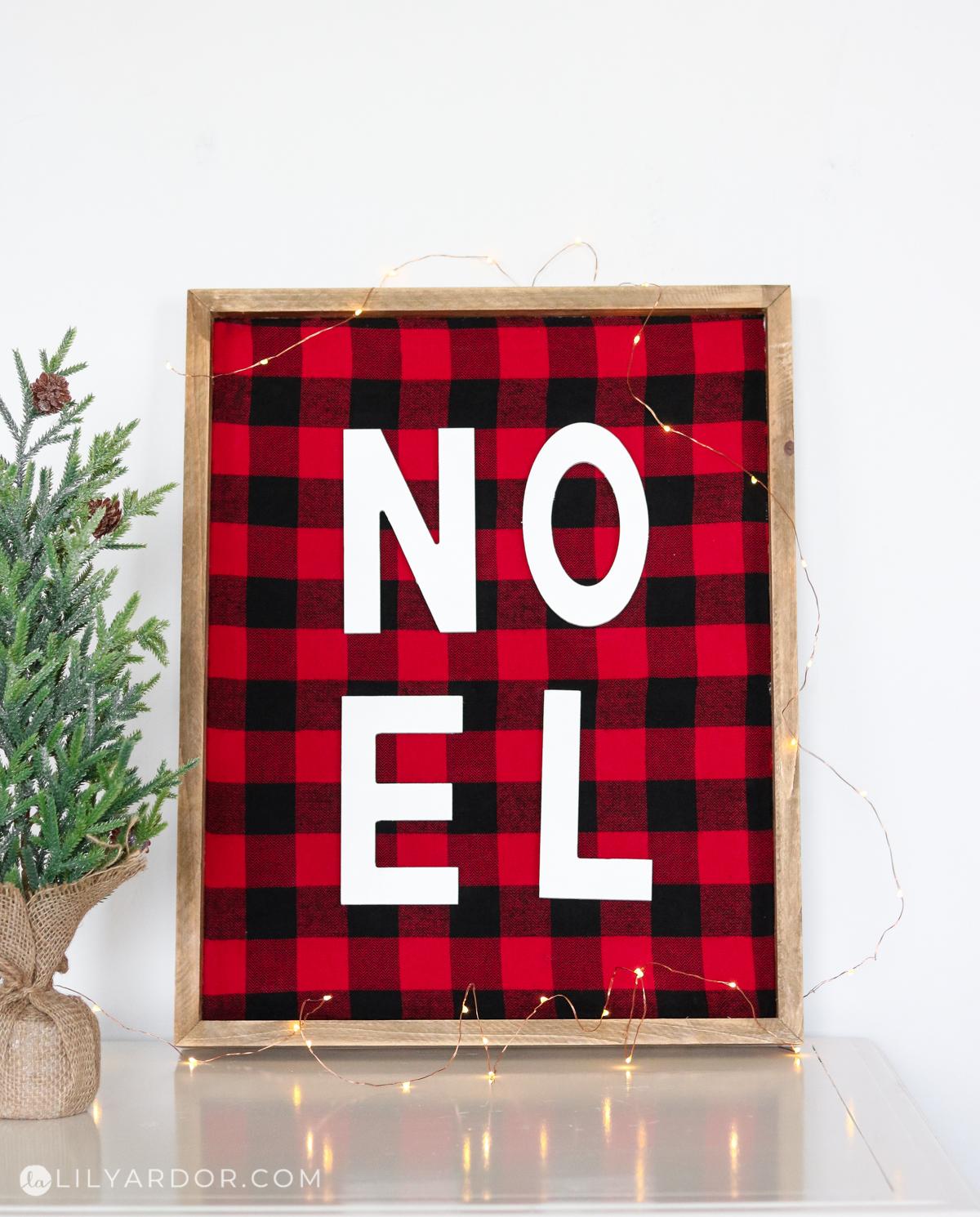A Noel plaid sign