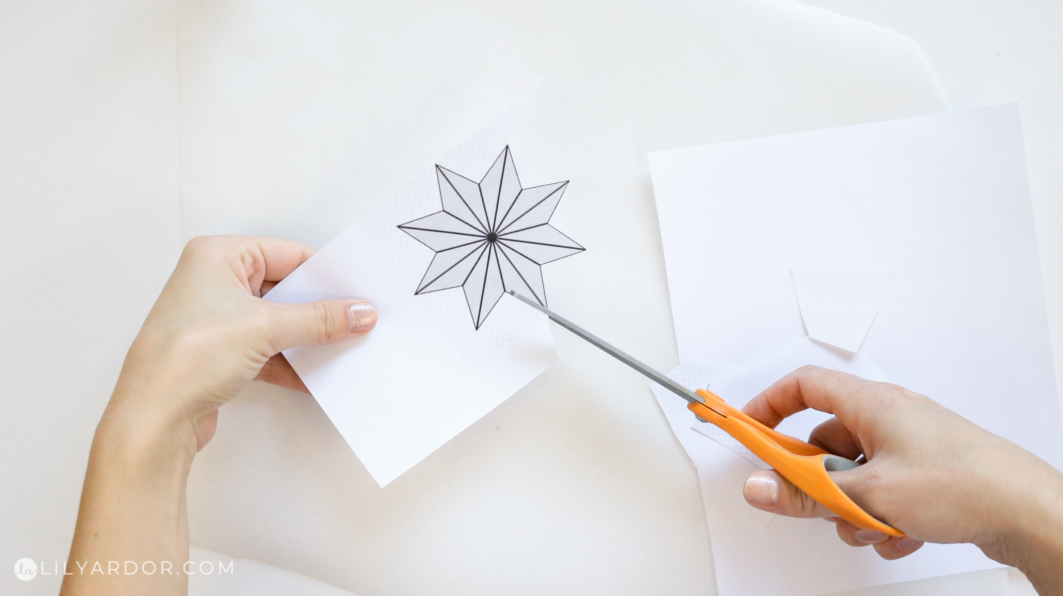cutting out a star stencil for candle holders