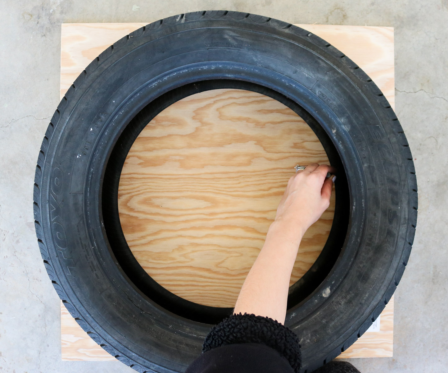 tracing the tire onto plywood