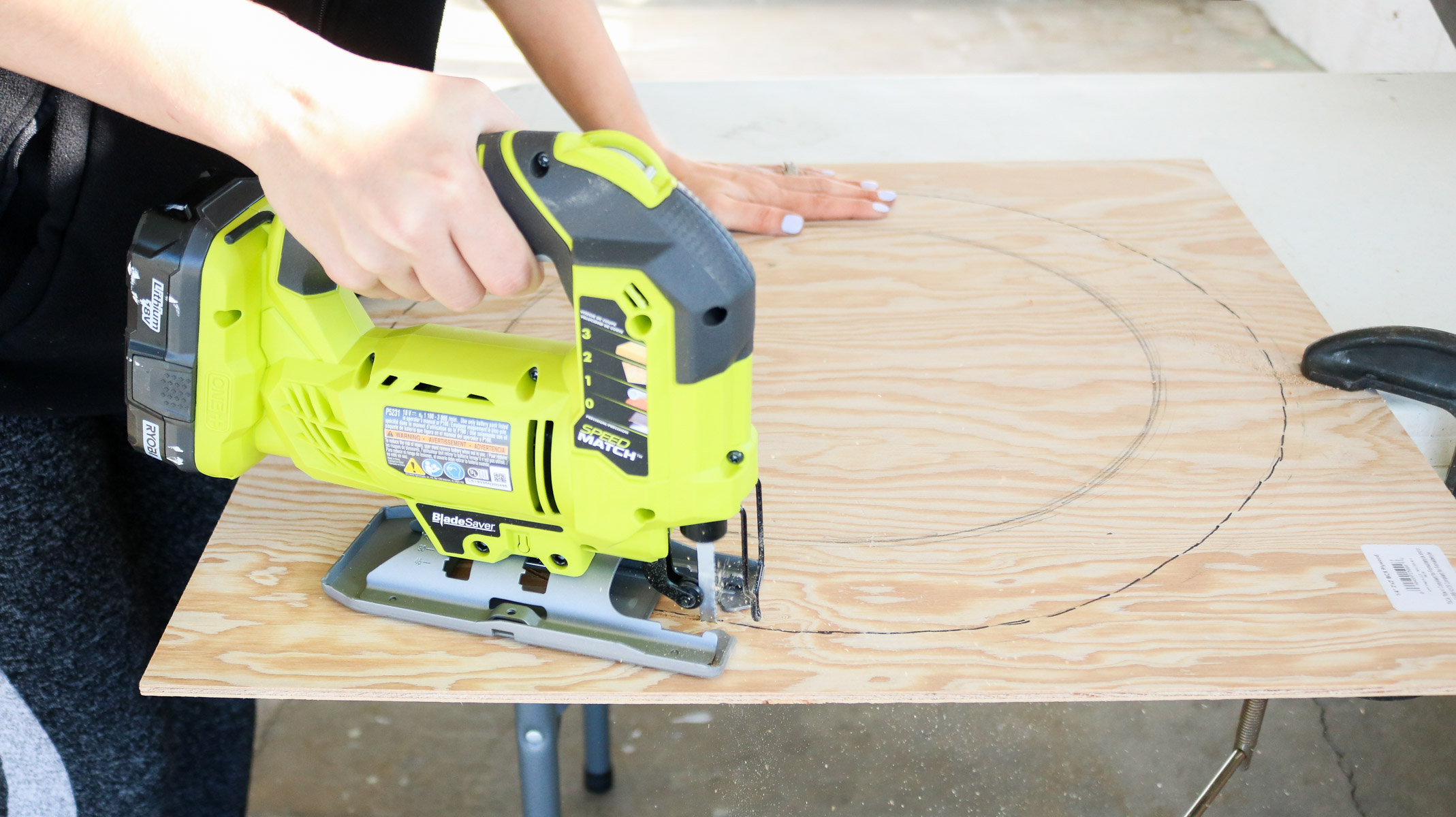 using a jigsaw to cut out the plywood
