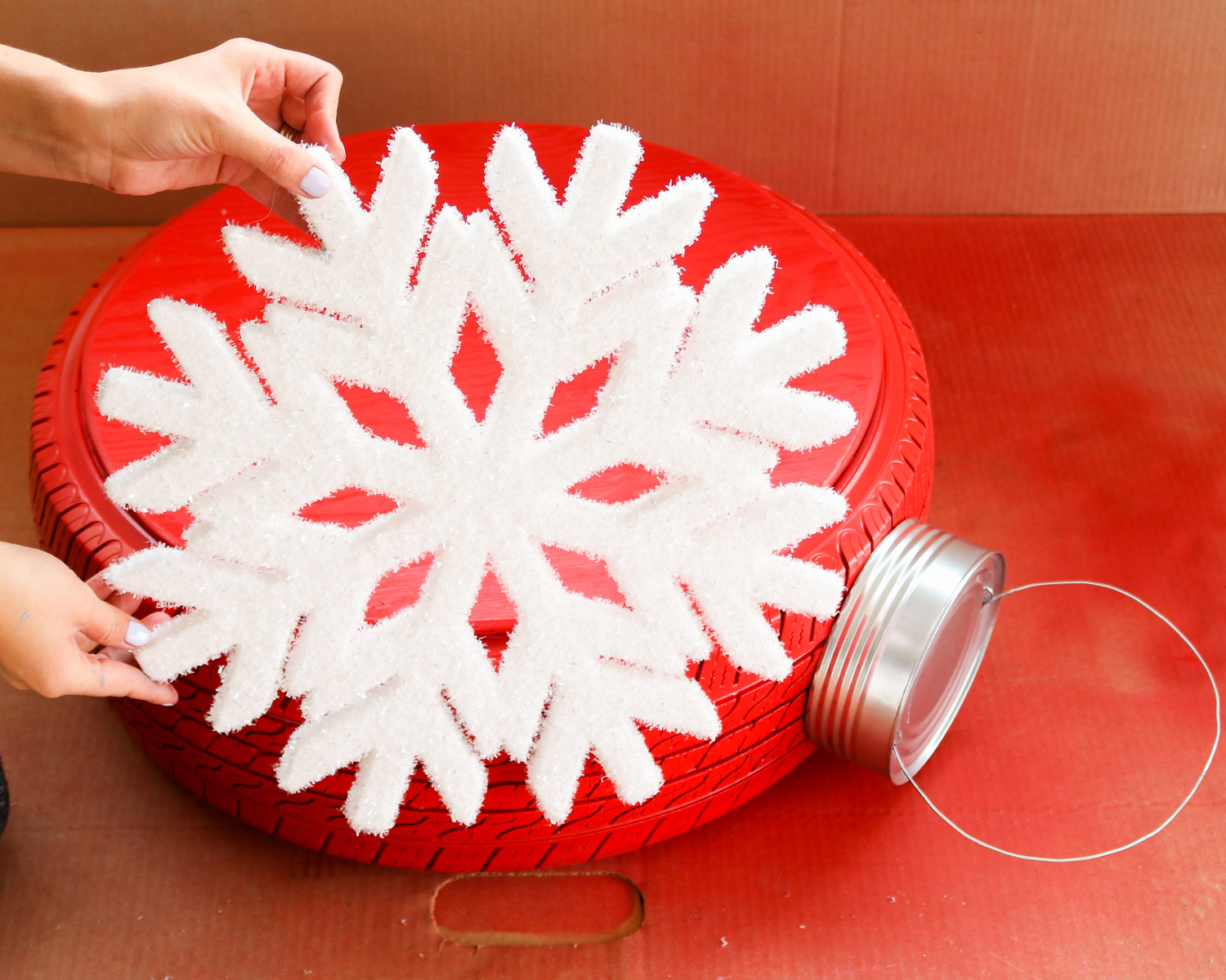 attaching snowflake to christmas tire
