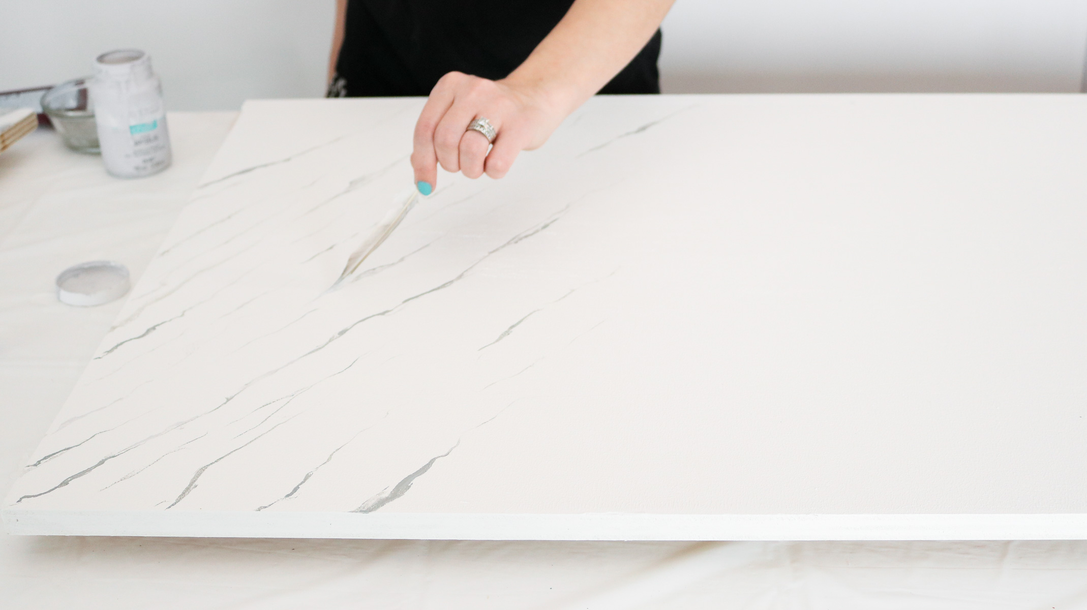 painting on the veinging for the DIY Marble Resin Countertop
