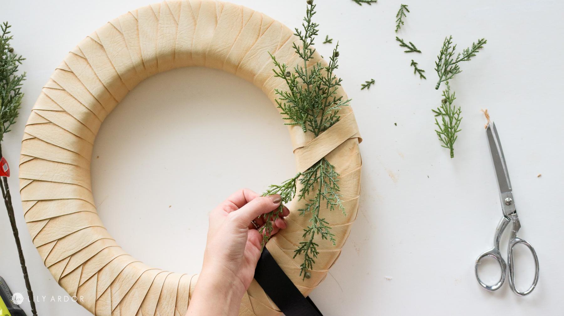 adding greenery to my DIY wreath